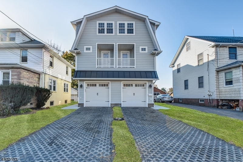 An amazing opportunity to own this home in Millburn. Built in 2018, this home offering 5 bedrooms, 4.5 bathrooms,1 attached garage across 4 levels of generous living space. Minutes walk to Millburn train station with direct service to NYC, top-rated schools, downtown, park, shops, restaurants. 1st level has combined living/dining flowing to eat-in kitchen with stainless steel appliances and quartz countertops.  Kitchen leads out to deck overlooking fenced yard offering privacy and great outdoor space. 2nd level contains the master suite with walk-in closet and private balcony and two other bedrooms. Basement level hosts a recreation room and an office with ensuite. The top level provides an additional 2 bedrooms, with hall bath and a huge attic storage space. Low taxes and no HOA!