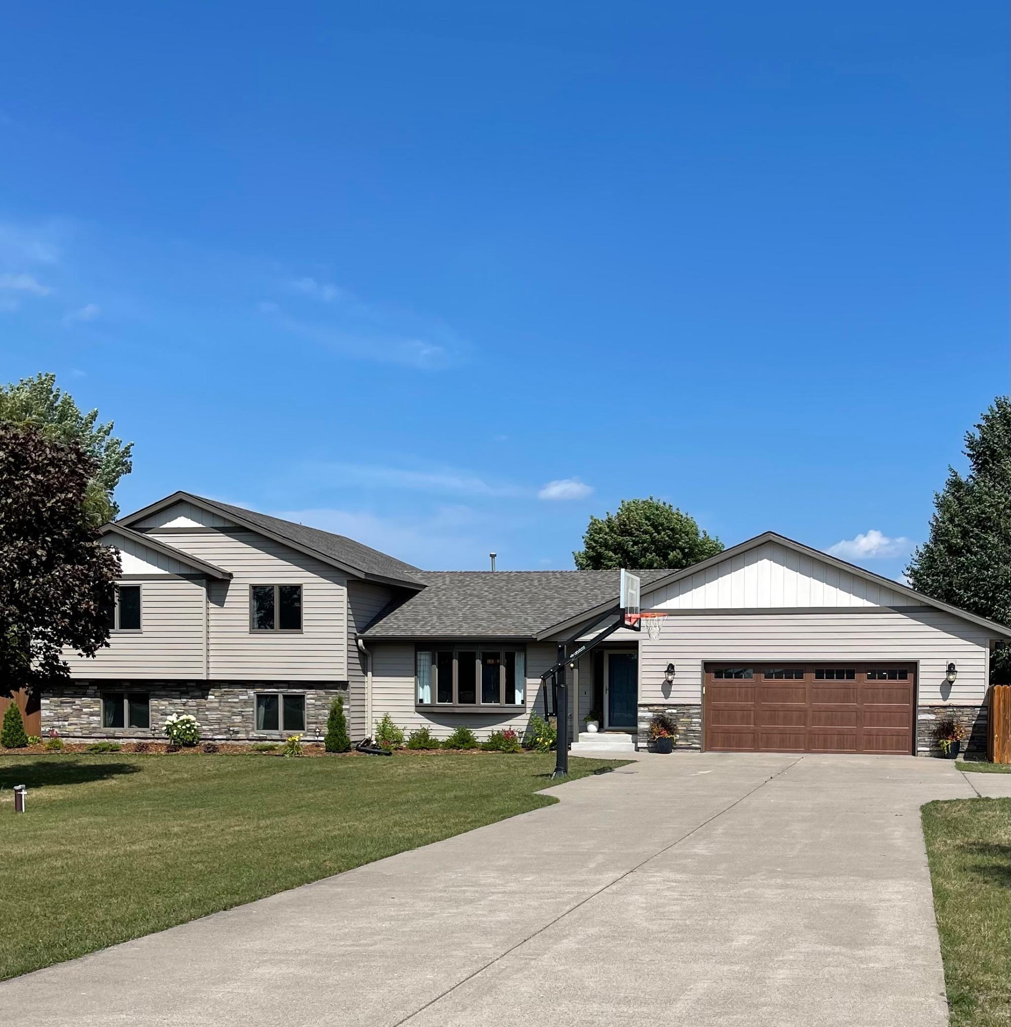 Country living close to the city with easy access to Highway 10.  This unique floor plan gives you the main floor open concept that is great for entertaining, 3 bedrooms on one level and main floor laundry.  Private back yard is completely fenced in.  Heated garage.   Many recent updates: Kitchen update in 2017,  laundry room update 2021, new tile master bath shower in 2021, new roof, siding  & deck in 2020, new furnace and air conditioning in 2020.  New landscaping in 2018.  Just to name a few.  *New Andersen patio sliding door in lower level and back service door in garage being installed beginning of August. *Please see full list of updates in supplements *Please see list in supplements of personal items not staying in home.