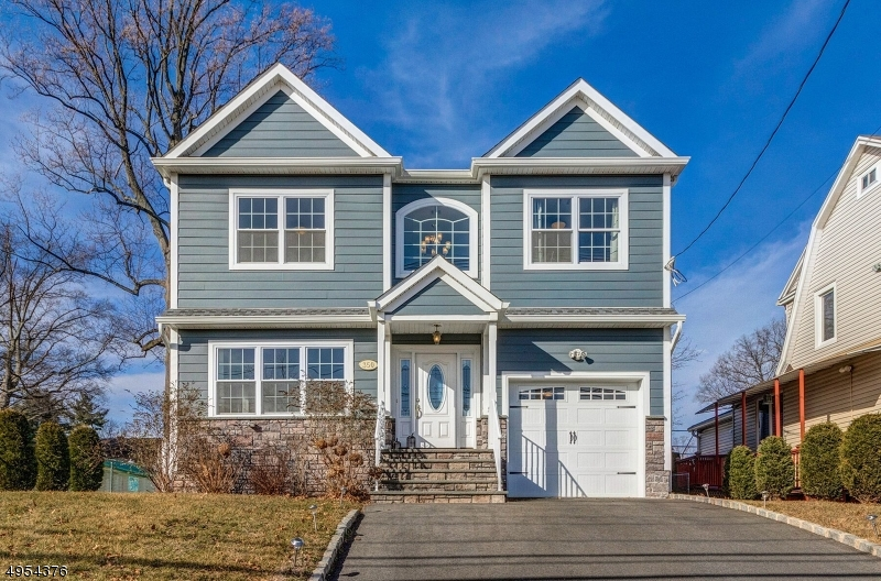 Built in 2016 with nearly 3,700 sq.ft of modern finishes ,colors and hardwood floors, this stunningly designed colonial home boasts all the bells and whistles a buyer could dream of. The open main floor boasts a contemporary chef's kitchen w/ white cabinets,quartz counters and SS appl, leading to a large dining room and family room w/ fireplace and sliding glass doors that lead to the private backyard oasis w/ a large deck, plenty of green space and multi-zone sprinkler system.The expansive second floor offers a laundry room,a palatial master suite with 2 W/I closets and spa-like bath and 3 large additional bedrooms.The finished basement features high ceilings, tile floors and a beautiful powder room. approx 6 years remain on HOW.1 block to shops, schools, houses of worship and NYC transport.