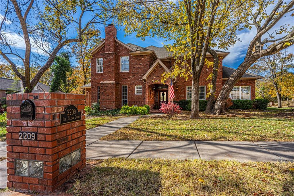 Fantastic Location in Heart of Edmond.  At the entry you are greeted by hardwood floors that extend into the kitchen. Your kitchen boasts a large center Island, Double Ovens and a large walk-in pantry. Large Kitchen Dining area. The Double Kansas cut stone fireplace in the kitchen extends to the family room.  Beautiful Plantation Shutters on majority of windows.  To the right of the entry is your formal living and dining and to the left is a full bath and study with fireplace and bookcase. The Master Suite is spacious and the Master Bath has it all including His and Her Walk-In Closets.  On level two find your spacious bonus room.  One of three beds has its own private full bath and walk-in closet.  Bedrooms 2 and 3 are separated by a Jack-in-Jill Bath with double vanities.   Brand New Hail Impact Resistant Roof to be installed this month.  Covered front and back porches.  Open Deck in backyard nestled in the trees.  Edmond Schools.  Schedule your showing today!