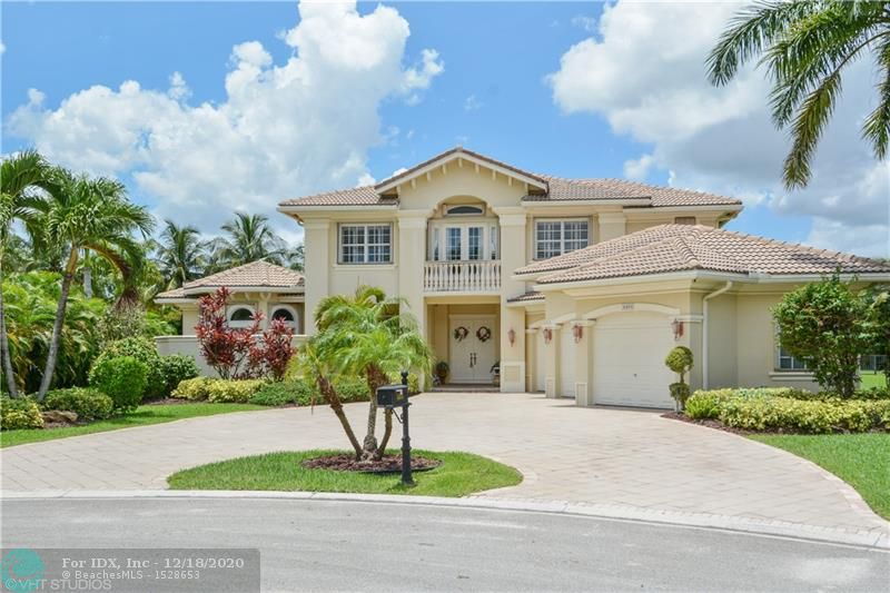 """Spectacular 5 Bed 5 Bath Two Story Home With Large Office & Custom Media Room On A 3/4 Acre Private Professionally Landscaped Cul-De-Sac Lot. First Floor Master Suite With Sitting Area, 4 Closets, His & Her Toilets, Bidet, Jacuzzi & Wood Cabinets With Stone Counters. Open Kitchen With Stainless & Panel Appliances, Double Wall Ovens, 42"""" Glass & Wood Cabinets, Granite Counters, Center Island, Pantry & Door To Large Dining Room. Resort Styled Pool With Raised Spa, Rock Waterfall, Bridge & Lazy River. Additional Features: Professional Home Office With Built-in Shelving & Wood Floors, Loft, Plantation Shutters, Central Vac, Marble Floors, Crown Moldings, Family Room With Wet Bar, Accordion Shutters, Circular Driveway, Fenced Yard, Immaculate Garage, Propane Tank & Much More!"""
