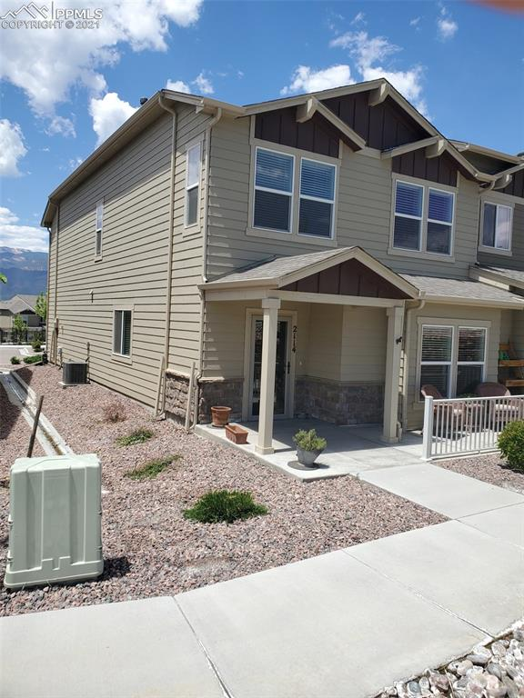 Beautifully maintained 2 year old, 2 story townhome in a fantastic newer neighborhood with amenities abound. Club house, fitness room, pool, jacuzzi, dog park, dog and car wash located just south of Downtown Colorado Springs, with easy access to I-25, and the Martin Luther King Jr. Bypass, going East and West. This two story townhome has wood laminate flooring on the main level to include the living room, kitchen and dining room. Granite counters, stainless steel appliances, gas range/oven, travertine backsplash, and lot of cabinetry adorn this wide open kitchen area, great for multiple cooks and entertaining. The kitchen is open to the great room as well as the dining area. Again a great family and/or entertainment home. Main level has an large 1/2 bath, and opens to the oversized 2 car garage which is completely insulated and drywalled. Upstairs you'll find your dream size master bedroom with views of the mountains and community center and pool. The master bedroom has a nice sitting area with wood accented wall, 3/4 bath with double vanities, a walk in shower with a tiled poured pan floor and bench seat, and walk in closet. The 2 upstairs secondary bedrooms have a full bath off the hall, and upstairs laundry room with a window, making it nice and bright. This is a maintenance free neighborhood centrally located for those who may work in various parts of town, it makes commuting easy. The homeowners purchased the home new and have added some additional upgrades like custom interior trim around the windows, wood-looking tile flooring in the upstairs bathrooms and laundry area, and a new vanity in the main level bath. The community center has pool tables, a kitchen and community room for private parties. Walking trails and green space areas are currently being added to the community. AC tops it all off! This home exudes pride of ownership and it shows!