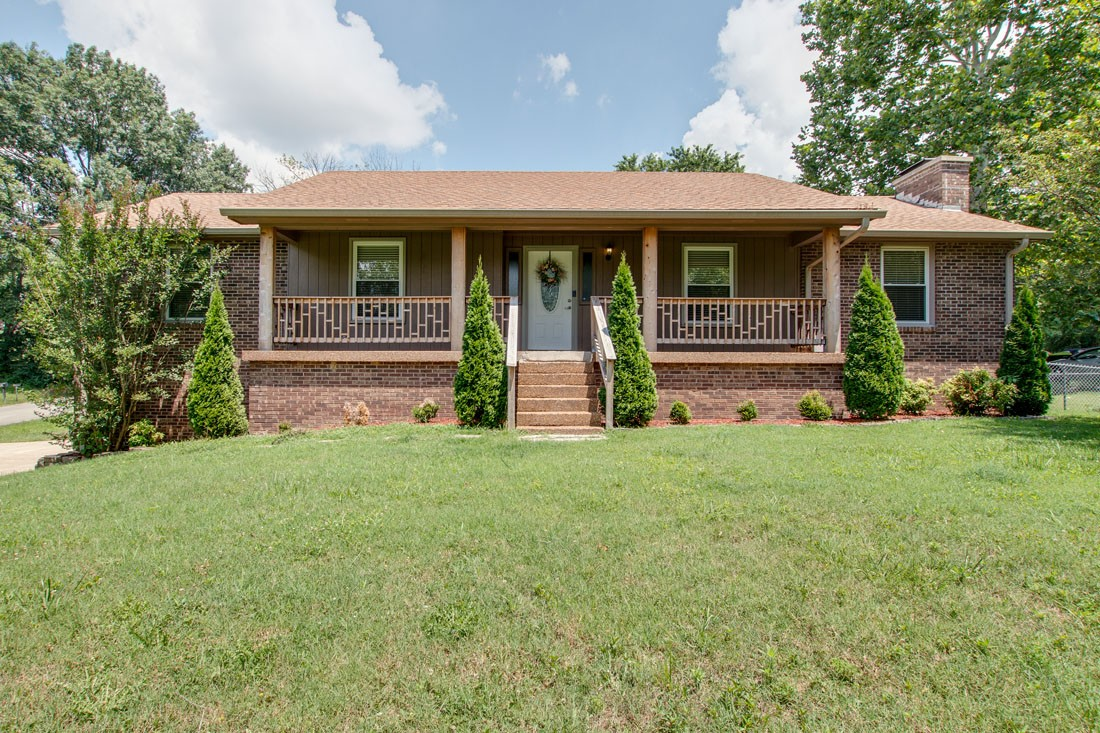Renovated All Brick Home on 1/2 Acre Lot! This home was Remodeled in 2015(including: Master Bath Renovation, Windows,Blinds,Floors, Kitchen, etc.) This Home Features:Finished Basement, Storm Shelter, 4 Car Garage, Solid Surface Flooring throughout the entire home (No Carpet), Wood Burning Fireplace Upstairs & In Basement, Fenced area of Back Yard, Large Deck, Large Covered Front Porch,Granite Counter-tops, New Chimney Top(2019), And Much More! No HOA! Showings start 8am Fri 7/10
