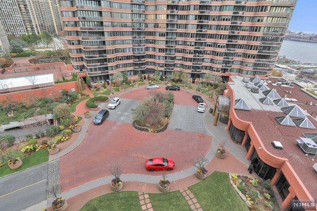 A Spectacular unit with many upgrades, freshly painted. Enjoy luxury living in this 1BR, 1.5BTH unit with STUNNING views of the Hudson River and NYC skyline. This bright unit features apporx 1100 sq ft with views from every room.  A/C units (2 of 3) and 2 toilettes and electric panel replaced in 2015, newer washer and dryer  Luxury amenities include 24 hr concierge, full time valet,outdoor pool,new excercise room,on-site cleaners,and, a community room. Easy access to NYC via NJ transit or, NY waterways Ferry. Maintenance included: hot & cold water,indoor parking, use of amenities. This unit has a designated covered parking spot #A17.
