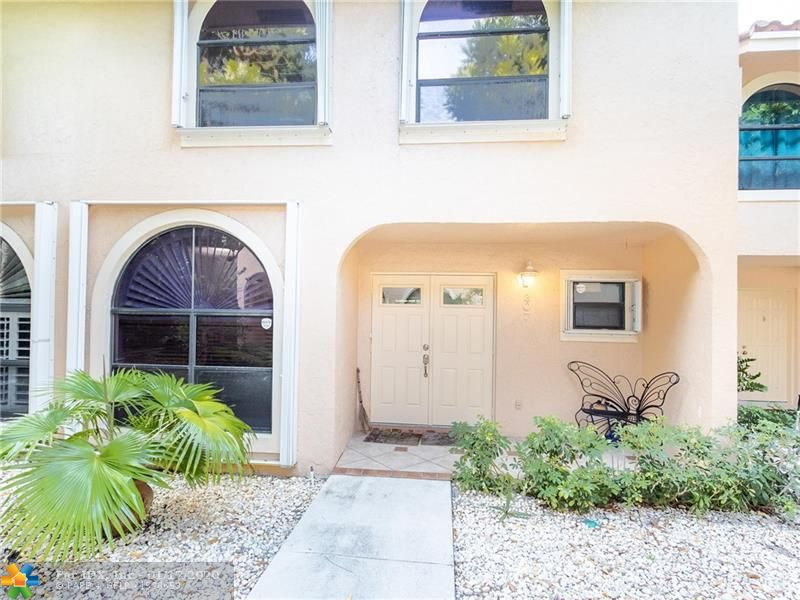 3/2/1 & WOW is what you will say!  Price Reduction.  This 1520 sqft Townhome/Condo is in Coral Ridge isles NE Fort Lauderdale. This property has had everything updated in the last 2 years.. Association just finished the new roof 2019 with assessment paid,  Owner has replaced the A/C 2019, Washer/dryer 2019, All new appliances 2018, Water heater and new Door 2016/17. large living room with a screened in patio with Hurricane Shutters. The association says pet friendly under 40lbs. Floranada Elementary school across the street, You may lease upon purchase 1 time a year annual lease only. This unit comes w/ 1 parking space assigned, Currently no assessments and unit comes unfurnished..