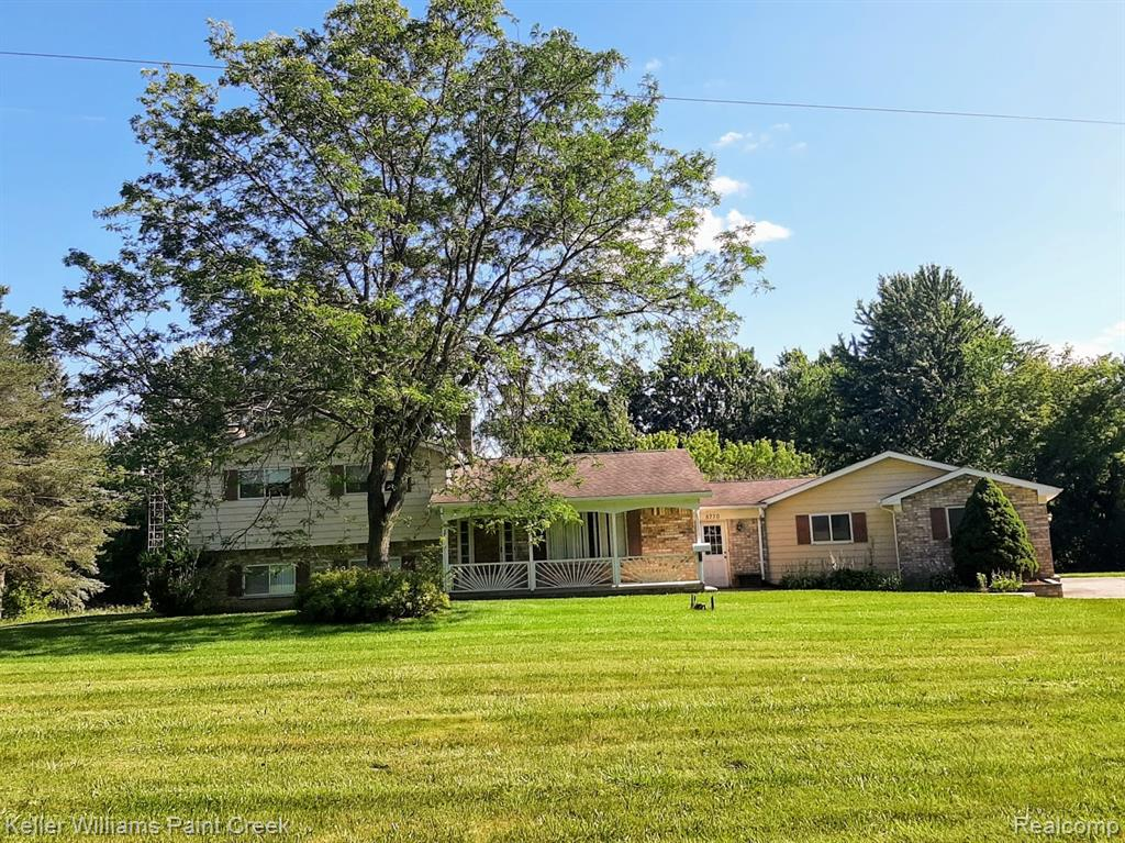 WOW! Almost 2,000 sq ft home sits on 11 acres! (possible splits?) 2 outbuildings: 1st building is metal, approximately 1,000 sq ft about 15 feet tall with 12 ft doors and electricity. 2nd barn is about 700 sq ft with electricity and water. The home is set up for a mother-in-law or teenager, has 4th bedroom, 2nd full bath, family room with gas fireplace and private entrance. Kitchen with island and nook.  Master has private access to main bath and two closets. Two entrances to the basement. Large breezeway with walk-in closet. Oversized entry garage with work area and storage. Back up generator! CALL TODAY!