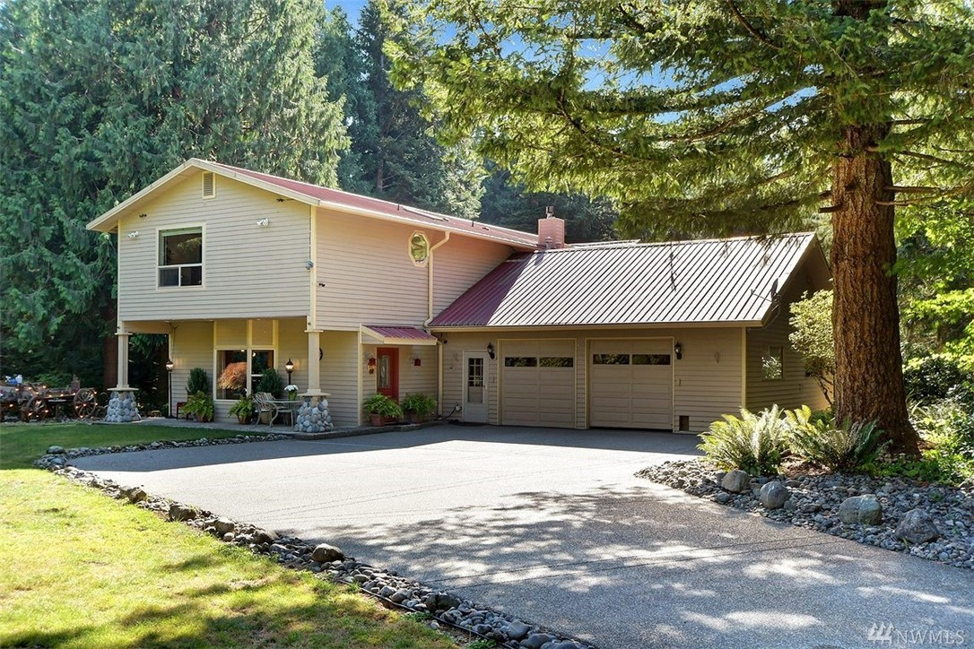 You might still have to work, it's true. But reward yourself! Working remote never looked so good: every day here will feel like the best parts of summer camp or childhood vacations – lush, landscaped, woodsy lot w/a creek running thru it & Lake Umek access for swimming, boating, fishing. This 1995-updated home features add'l outbuildings & oversized garage/shop, privacy, your own trout pond…but it's not that far to those busy places like Issaquah, Kent, Seattle, Bellevue. Welcome to Serenity.