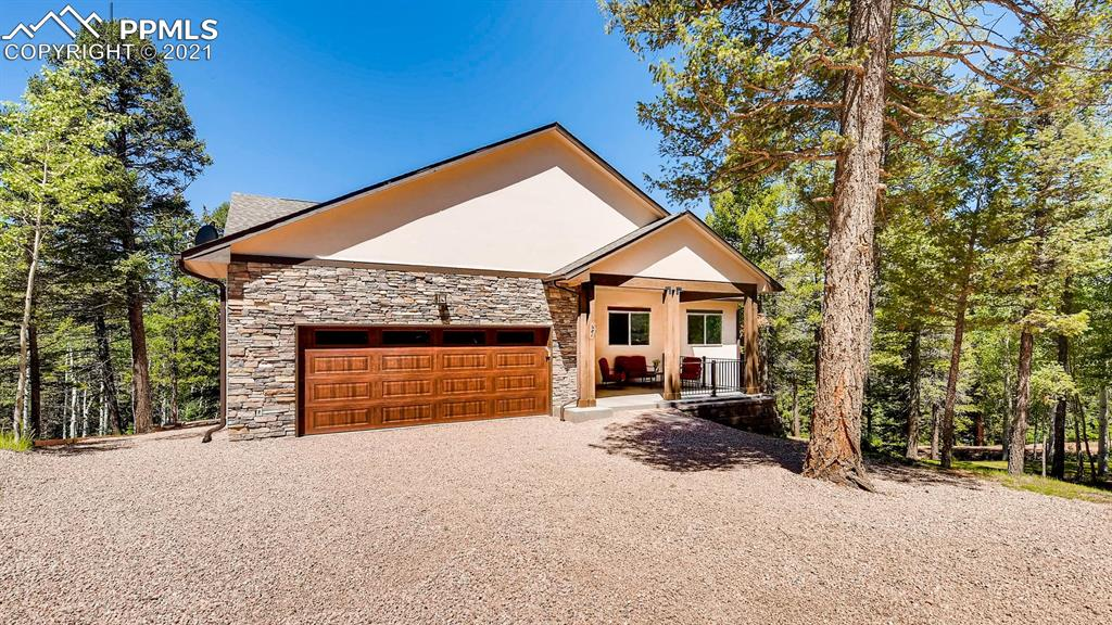 Must see! This beautiful custom built home has barely been lived in! Peaceful aspen & pine forest setting w/lovely mtn views. Very open & spacious floorplan both levels, & SO MANY QUALITY TOUCHES! Owners added $83k in upgrades since original build. Main Level features hickory hardwood floors & cabinetry, designer lighting, stone gas f/p, 8' slider & 8' picture window, huge 14x7 master walkin closet, kitchen cabinet pullouts, SS appliances, pantry. Beams, vaulted ceiling, lg laund rm w/sink, huge 20x14 covered front porch,