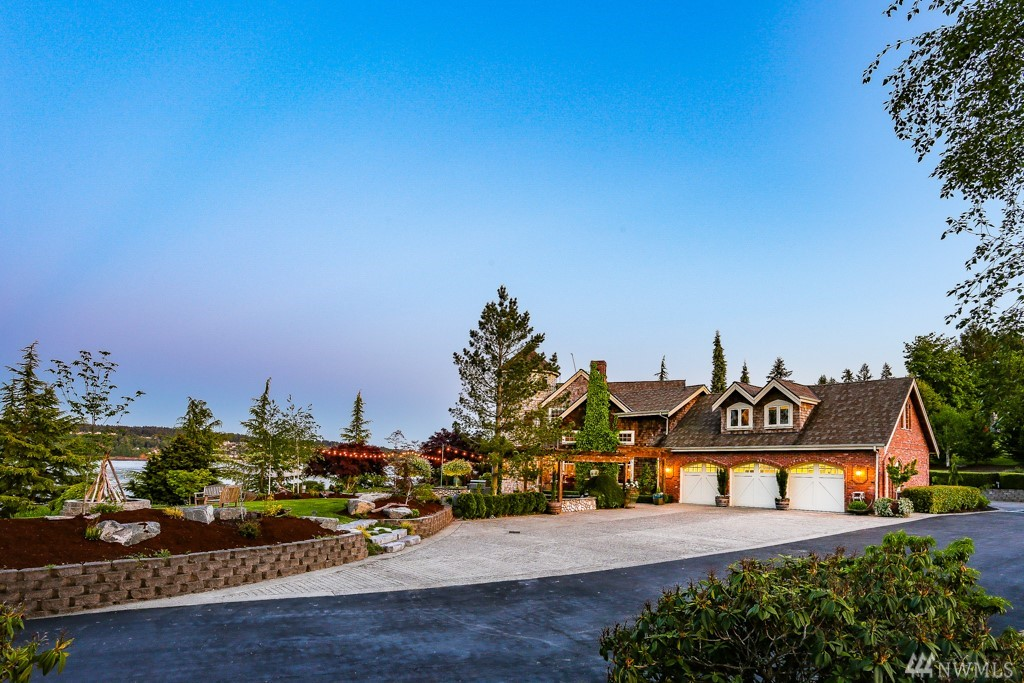 A private & gated 3-acre estate on 380' of low-bank waterfront w/ tideland rights & rare 175-foot deep-water dock can be yours! Just 75 minutes from Seattle & Bellevue w/ bridge access, imagine life on water's edge! Inspiring Puget Sound, Mt. Rainier & Chambers Bay views. Unrivaled outdoor spaces perfect for quiet evenings & large-scale entertaining. A circular drive leads you home to your chef's kitchen, billiards & bar. Additional 50' of waterfront on 11 acres w/ shop and barn avail for $905K.