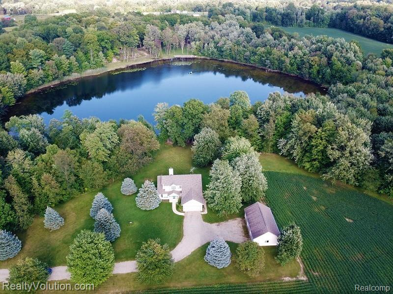 AMAZING LAKEFRONT opportunity on 10 secluded acres. Hard to find lake front homes with such privacy and seclusion like this offers. Priced to sell fast. This one owner custom built home has everything you want- 10 square secluded acres, 2.5 car attached garage plus a 3 doored 24x40 pole barn with electric, finished walkout basement, closed loop geo-thermal heating and cooling, and a private lake to enjoy fishing and swimming in.  Owner built this with quality and has meticulously maintained it since. Andersen windows, stone surrounded woodstove that can heat the home too, first floor master suite and first floor laundry, wood floors. All appliances included. Upstairs is the 2 guest bedrooms and a full bath. Finished walkout offers kitchenette & great room perfect for whatever suites your needs. Large back deck to enjoy the peace & serenity. New roof in 2016 too.  All you will have to do is move in. PUBLIC OPEN HOUSE SATURDAY SEPT 4 from 11am-1pm.