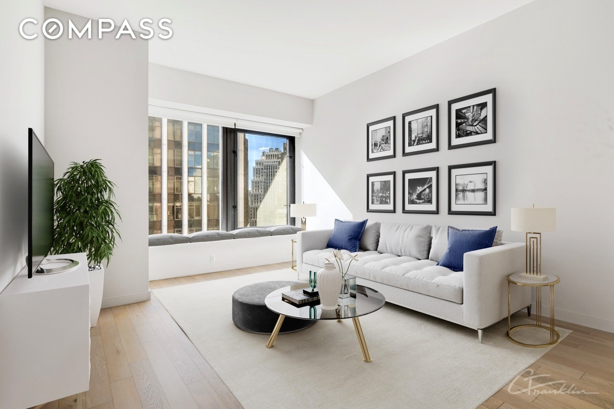 This spacious apartment has soaring 10ft ceilings and oversized windows. With a South East exposure and plenty of direct sunlight, it serves as an ideal retreat in the heart of the Financial District. 23E features a sleeping alcove, state of the art Italian kitchen, washer/dryer in the apartment and a large bathroom including a separate shower and tub. 75 Wall is a full service condominium, located above the Andaz Hotel by Hyatt Corporation, and features over 30,000 square feet of luxurious amenities; including a fitness center, Roof terrace with 360 degree views, a lounge featuring a full kitchen and bar and so much more. Conveniently located in the Financial District with 2, 3, 4, 5, R, N, J, Z, A and C trains in close proximity.Lower Manhattan has become a destination for world class shopping and dining options by renowned chefs. Recent hotspots include Nobu, Manhattan, Crown Shy, Augustine, and Temple Court in the newly renovated Beekman Hotel. This is your chance to live the SoHo lifestyle in the hottest new residential neighborhood in the city steps from Dining and Shopping at Eataly, Brookfield Place, Calatrava's Oculus, and The Seaport. Convenient to ALL major subway lines going uptown, Eastside, Westside and to Brooklyn.Welcome To The New Downtown!