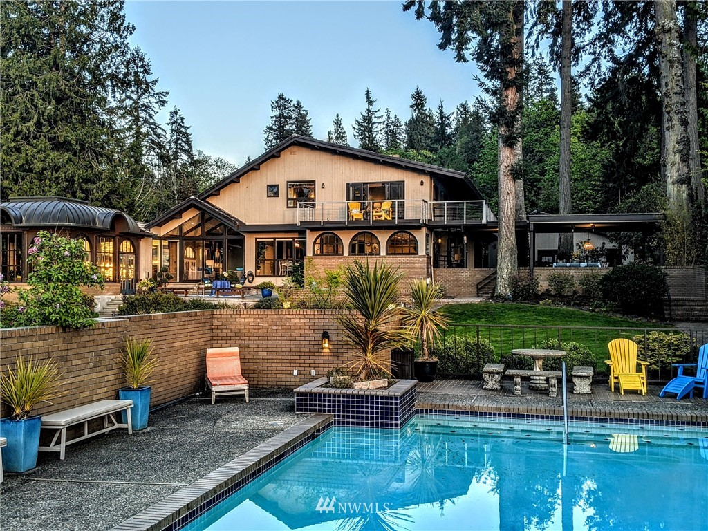 """Gig Harbor's famed """"Gold Coast"""", with its incomparable views of the Olympics, Henderson Bay, & glorious sunsets completes the package for this most distinctive mini estate.  The gate opens revealing a myriad of treasured spaces & bold statements of European style - a Swiss mountain inspired chalet, Victorian era copper conservatory, Mediterranean themed pool, courtyards & gardens, even a darling 2 stall stable.  Inside is a delightful blend of grand & casual as stately midcentury meets contemporary in 5000 sf of living & entertaining space.  Fantastic new kitchen & all new master retreat.  It's that special place offering something for everyone, every day, every season - for memories to be made to last a lifetime!"""