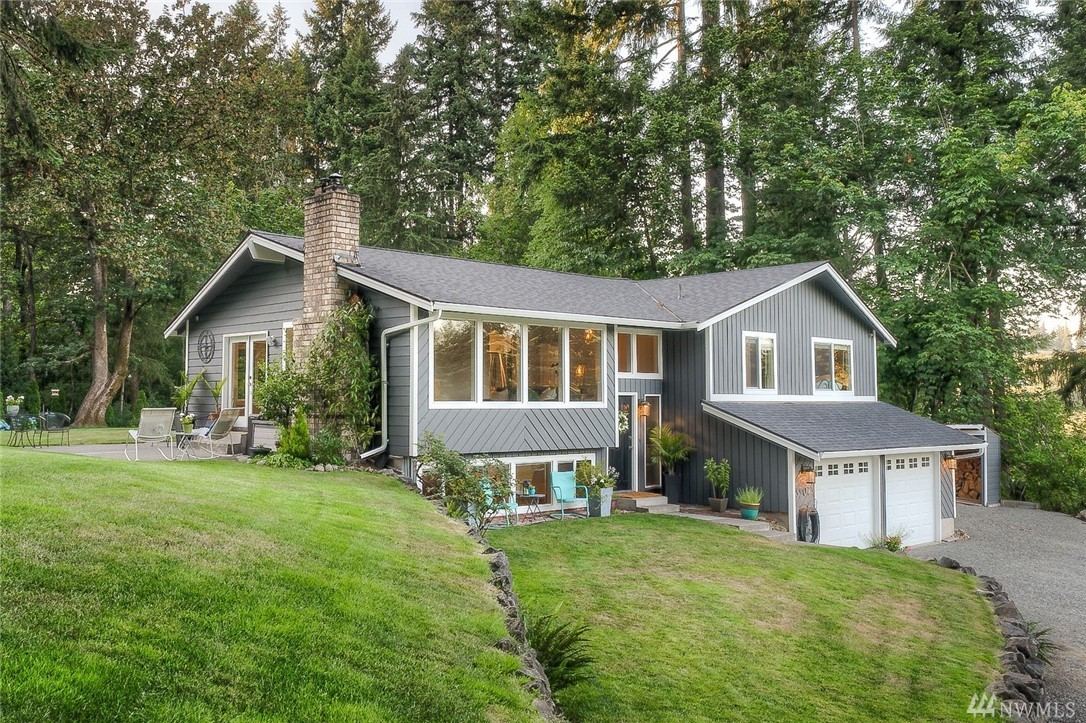 Captivating pastoral/mountain views, lush green landscape & a calming 1 acre of privacy highlight this Enumclaw beauty. The *FOUR* bedroom home is meticulous from top to bottom. Fully remodeled kitchen feat. fresh white cab., quartz & stainless app. Open floor plan w/ vaulted ceilings, hardwoods, cozy fireplaces, wall of windows to bring nature in & a flexible rec. room. Each bathroom boasts a designer remodel. Master w/ walk-in & barn door accent. Quiet, dead-end rd. w/ easy access to Hwy 169.