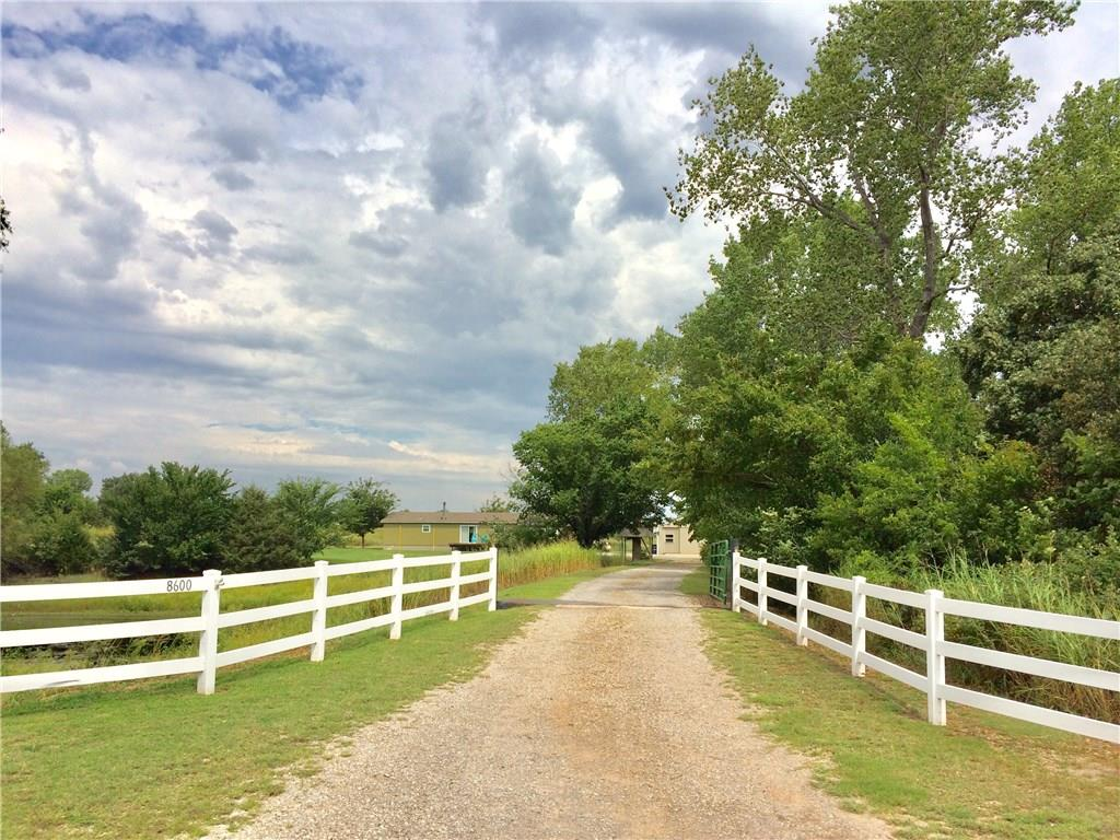 Amazingly beautiful country property awaits you! The memories will be many on this 4.97 acre setting in the Deer Creek school district. Large stocked pond fed by rain run-off, pasture for horses, 30x40 workshop/garage/barn with electricity and built-in storage lofts, attached covered parking on the north side to park additional equipment, boat, small tractor, etc.. Solitaire home is in excellent condition. Can be moved with an Attorney Title Opinion. Large mud porch, deck on house & pool. Great location! 9 min to Prairie Vale Elem, 10 min to Deer Creek MS, 17 min to Deer Creek HS, 13 min to WalMart & other stores. Easy access to I-35 & Hwy 74. Live on-site in a nice home and store your belongings in the 30x40 garage, while you build your desired country dream home! We are welcoming builders & developers. The potential is great, with many possibilities, from the personal buyer to the developer/builder.