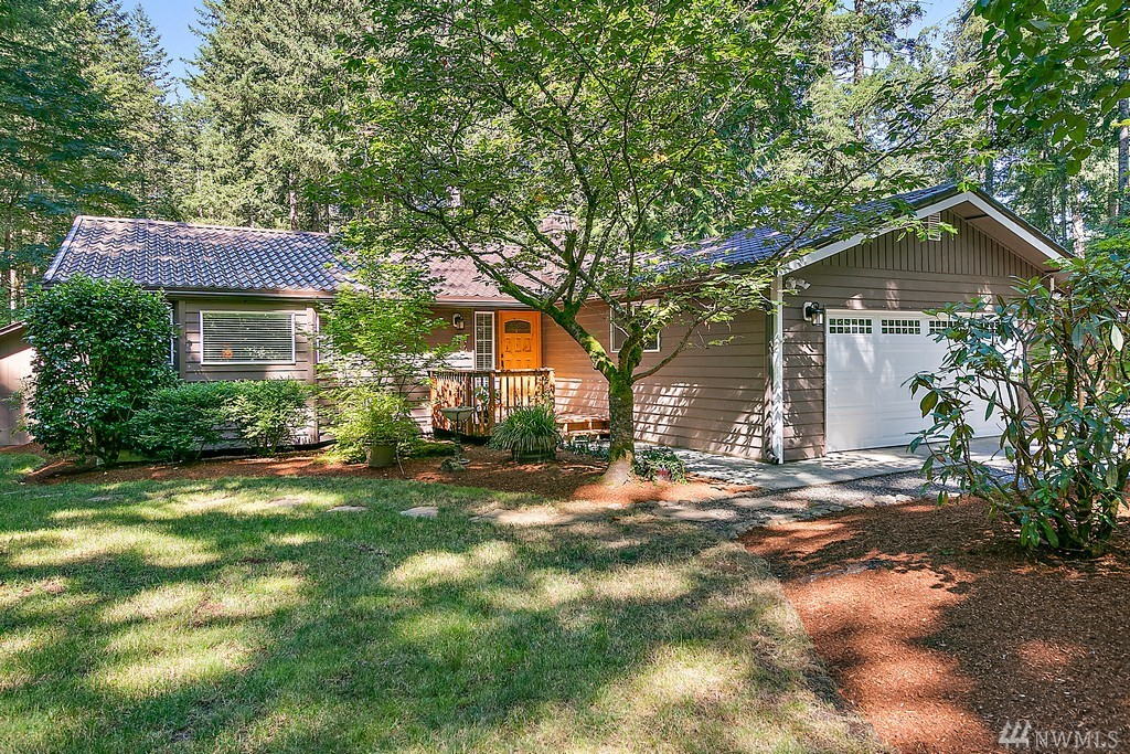Located near gorgeous Lake Retreat down a private drive on over an acre lot sits this welcoming & well-maintained rambler. Main living space features large windows that look out on the beautifully maintained yard and wrap-around deck. Large kitchen opens to dining on one side and great room on the other, featuring a wood-burning fireplace. Owners suite has a remodeled full bath and slider to back deck with hot tub. Park-like grounds, fire pit and outbuilding. This is a must see!