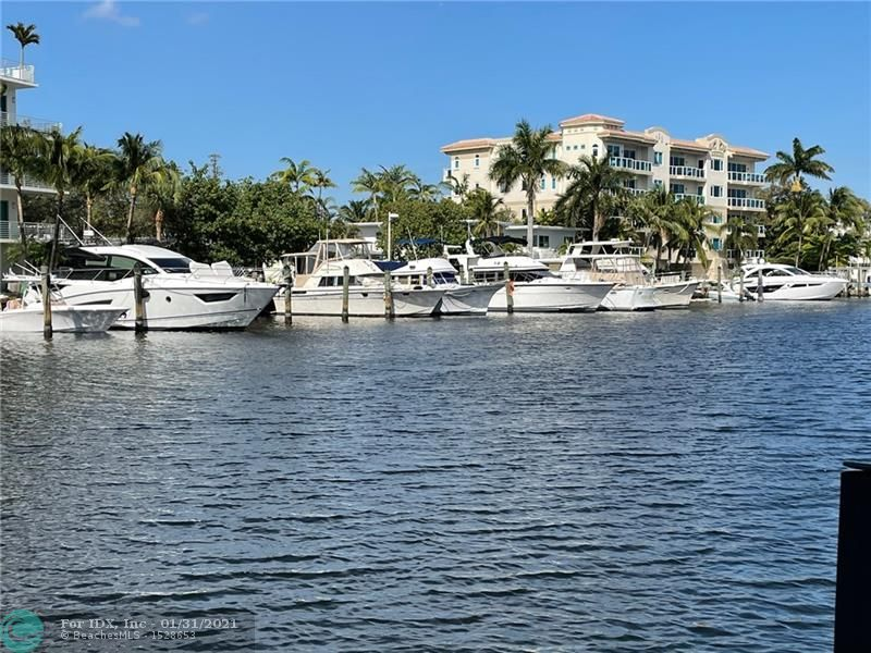 This mid-century one-of-a-kind 2-story townhome directly on the Rio Barcelona canal which surrounds the Isle of Venice is in the heart of Fort Lauderdale just minutes from the beach and downtown action yet in a serene and quiet complex. Originally 2 one-bedroom units professionally combined with an architect to create this custom unique beauty. The water views from inside will amaze & give you a feeling of floating on a yacht. You will easily recognize the quality with which the sellers completed this update including marble floors throughout, custom stairs with marble slab steps, kitchen aide appliances, wood cabinets, granite tops, built-in bar area w/lots of storage, blinds, washer/dryer++. Included in sale 2 storage units, a boat, the furnishings, and 2 parking spaces with one covered.