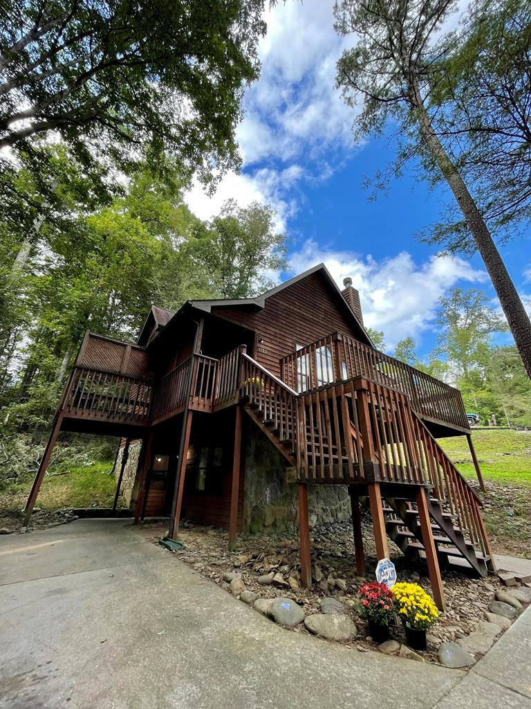 This 3 bedroom 2 bath cabin  is located in an easily accessible and desirable Gatlinburg neighborhood.  The spacious bedrooms and living room, closets in every room,  and a full size laundry make this a great rental or permanent residence property.  Outside you will find two decks, one private deck that would be perfect for a hot tub, a larger deck to enjoy the outdoors and a long drive way that can accommodate up to 5 vehicles.   Showings available immediately, call to schedule.