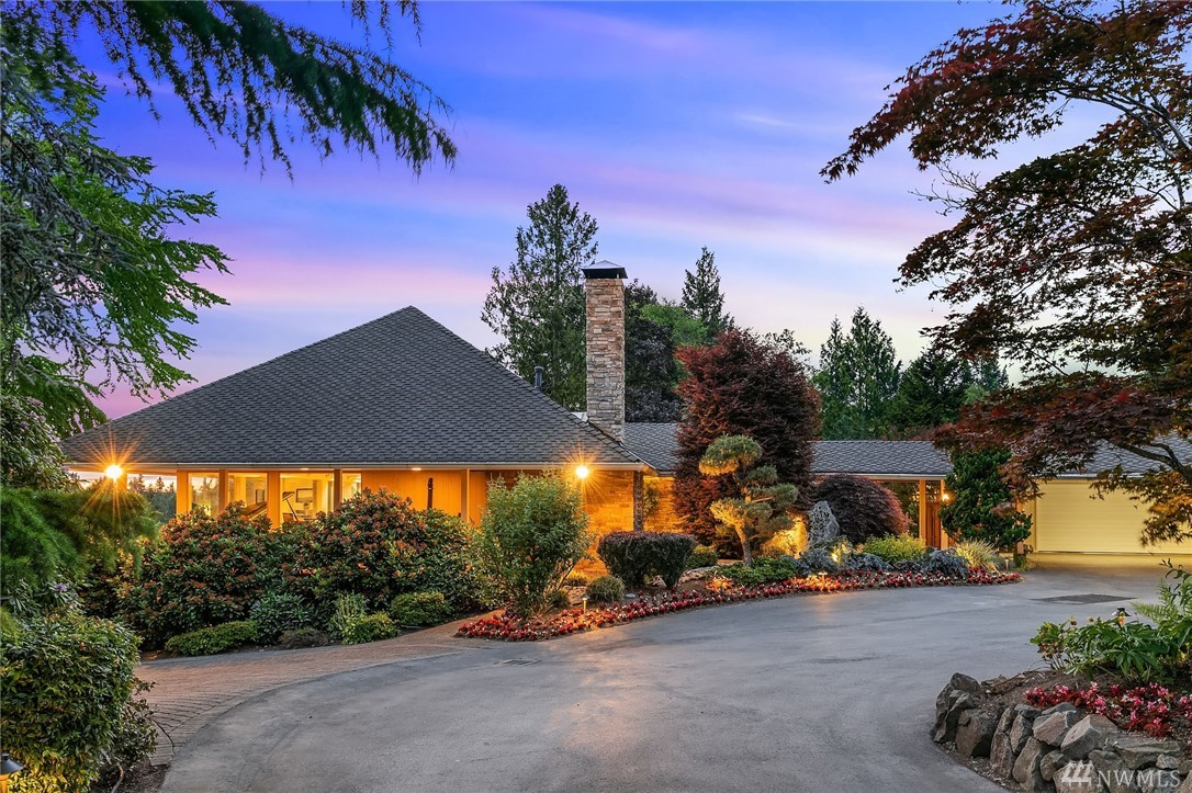 Gorgeous 4 BD/ 3.5 BA estate on 3rd hole of Glendale Golf Course. Light filled great rm w/ skylight & wrap around windows overlooking GC, dwntn Bellevue & Olympic Mtns. Master suite on main w/ his & her baths. Multi level deck, lower level rec room w/ billiards & media area w/ patio & private putting green+sand trap. 2 oversized rooms downstairs. Upper & lower W/D's. Guest suite on main. Expansive 3 car garage w/ shop. Porte Cochere parking & walkway from garage &carport to house.Generator & AC.