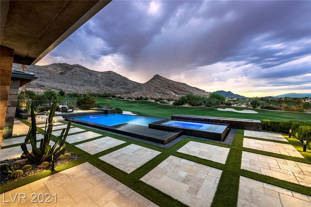 Iconic, guard gated 1-story w/picturesque mountain & golf course views. Located on the 5th fairway of Red Rock Country Club's private Mountain golf course. Desert-inspired living w/glass walls & sliders, tumbled travertine flooring, custom architectural elements, split-cut marble, & a floor plan modified to maximize space & celebrate the view. Custom 140+ bottle wine cooler. Fireside living room lounge. Family room w/5.1 surround sound. Formal dining room w/courtyard access. Chef's kitchen w/Sub-Zero refrigerator/freezer & Viking Professional appliances. Resort-style yard w/Kalamazoo outdoor kitchen, covered patio w/fireplace, infinity pool, & zero-edge spa. Owner's suite w/yard access, generous walk-in closet, & fully outfitted zen bathroom w/heated floors & custom storage & lighting. Spacious den/office. All beds en suite. Control4 system, AquaLink pool automation, new LED lighting w/Lutron switches, Nest thermostats & smoke detectors, security sensors, & new epoxy garage floor.