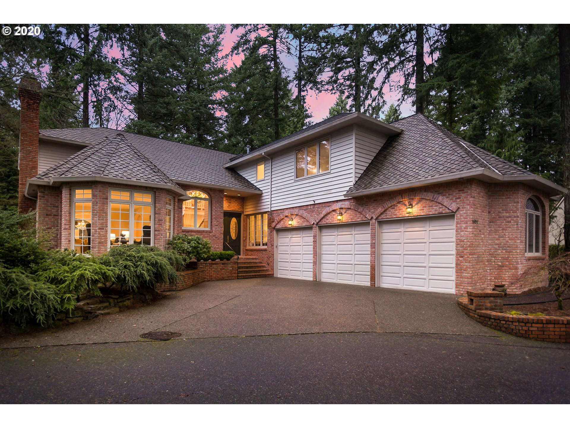 This classically elegant home located in Lake Oswego's sought-after Village on the Lake neighborhood is beautifully maintained & filled with contemporary updates that complement its traditional style. With access to the best marina on the lake, this area is known for its community events and easy waterfront lifestyle for all it's homeowners. Great floor plan with all 4 bdrms on the upper level including nanny/in-law quarters with kitchenette. On a private lane with forest views & low-main. yard.