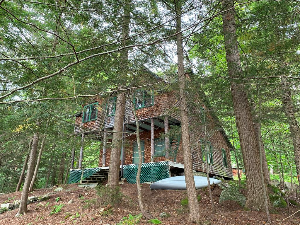 """Do you love the idea of living with history? This 1900 building is yours to restore, make your own memories and continue the history of """"Eddystone Lodge"""". Plenty of old growth trees protect your privacy and the 200' of waterfront has a typical Adirondack shoreline. The two slip boathouse and dock make a great place to sit and enjoy the water on Fourth Lake. The older dwelling has 4 bedrooms, 1 bath, kitchen and living room. There are two more cottages on the property which were added later. The middle guest cottage has a screened porch, kitchen, living room, bath and a half and bedroom. The latest addition offers two bedrooms, full bath, kitchen and living space with a wood stove. From this location you can enjoy the southern exposure for three seasons."""