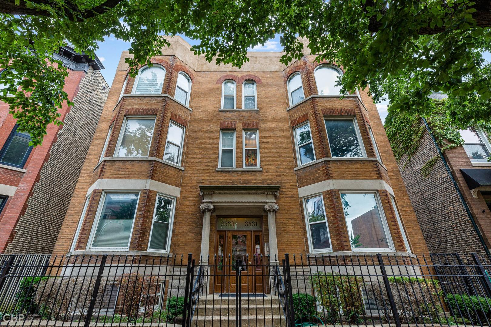 Don't miss this opportunity in the heart of Wrigleyville steps from Wrigley Field to own a large condo price to sell. This large 2 bedroom or turn back to a 3-bedroom home with 2 and 1/2 baths duplex is an opportunity waiting for you. This home has 2 family rooms and separate dining room, exposed brick and tall ceilings providing natural light. Both bedrooms are good size and have ample closet space. The kitchen has white wood cabinets and stainless-steel appliances. The kitchen also has a walk-in pantry and is steps away from your deck to grill. The family room in the lower level is currently being used as a bedroom however the space lends itself to be another large family room area.  This has a good size laundry closet with full size washer and dryer. Included in the price is a tandem parking space allowing 3 cars to park comfortably.    This location cannot be beat. Short walk to Starbucks, Whole Foods, and Lake Shore Drive. Another 10-minute walk to all the shops and restaurants at South Corridor and all the newer restaurants around Wrigley, like; Swift & Sons Tavern, Big Star, The Roost, Do-Rite Donuts, all quintessential Chicago eateries, and much, much more.  Call Steve today to set up your showing.