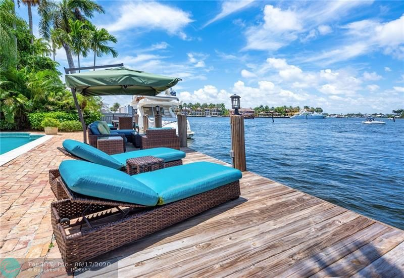 Among the Widest Views in Fort Lauderdale. SW Exposure: City & Intracoastal Panoramas. 130 Ft Straight Line Dock fits 120 Ft Vessel. Canal approx 120 Ft in Width and should Accommodate most wide beam Yachts. Boaters & Builders Have Five Ft Side Setbacks. Palm Beach Style Traditional Home. Great Room: 15 Ft Coffer Ceilings, Wood Burning Fireplace. Entrance Gallery Measures 8'x33' with 12 Ft Beam Ceiling. Master BR: 10.5 Ft Tray Ceilings, Walk-In Closet, Walls of Glass View Water. Master Bath: Spa Tub, Walk-In Shower, Two Wash Basins. Octagon Stair Tower is 18 Ft High with Wood Beam Ceiling. Family Rm/Library: 11 Ft Ceilings & Walls of Glass View Water. Approx 35 Ft Heated Pool. Walled & Gated Entrance with Chicago Brick Motor Court. Two Bedrooms on Entry Level & Two Bedrooms Up.