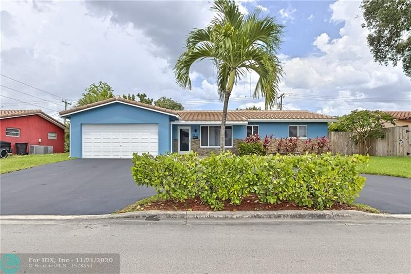 Completely remodeled 3 bedroom 2 bathroom home in Coral Hills! Newer Kitchen with high end stainless steel appliances including dishwasher and microwave, quartz counters, ample cabinetry and counter space, snack area for small table, laundry room with front end washer and dryer and extra storage area off kitchen.Full 2 car garage large enough for 2 cars and room for some storage. Beautiful grey tile flooring throughout entire home, looks brand new.Everything in home was redone within past few years. Freshly painted inside and out. All NEW hurricane impact windows and doors......only one room doesnt have impact windows.Central A/C, water heater and roof are 3 years old. New fence in backyard on all sides. Driveway with fresh coat of blacktop. Plenty of space for a pool. Show well! LOCATION!