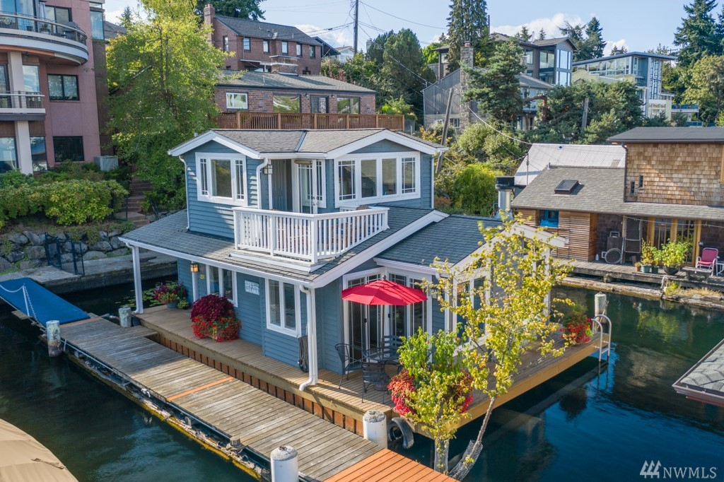 Own the only 2 floating homes on this dock while enjoying the perks of living in a fantastic community! Included in the sale of this beautiful home is the luxury end of dock home next door! Newer construction w/ beautiful craftsman architectural details & an abundance of closet & storage space. Both homes have high end finish work, views across Portage Bay through the cut, & offer never ending boat parade + city living coupled w/ peace & serenity of nature. 5 bedrooms total + 2 parking spaces!