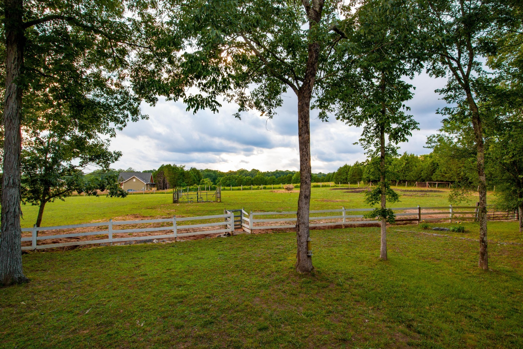 Bring your horses! One mile from Williamson County line. Beautiful sunset views at the quiet country home with two front porches overlooking serene pasture. Plenty of walking/hiking trails, great 4-wheeling, tree house, 3500 sq ft barn with large loft and storage space for hay and/or equipment. Must see to view all the amenities. Priced below appraisal and ready for new owners.