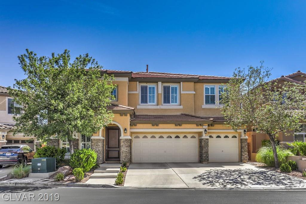 Highly upgraded Summerlin beauty w/modern pool & hot tub. Open concept gem w/custom paint and multiple living areas. Designer kitchen w/granite, dbl ovens, custom cabs, island, eat-in-area & butler pantry. Master suite w/balcony, huge w/i closet, sep w/i shower/Roman tub. Massive loft, Mt views, sec cams, sep laundry, 1BR & full BA down, 4/5 BR's w/w/i closets, finished garage. Resort-like private backyard w/heated pool/spa, patio, pro landscape.