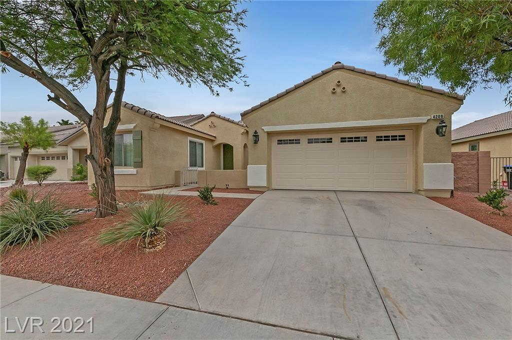 AMAZING SINGLE STORY HOME IN WATERFALL NEAR ALIANTE! This exciting home is show stopper!! It's located in a beautiful established tree lined neighborhood, 4 BR, 3 Full Baths, 10 Ft Ceilings, Open Floorplan with Lots of Light & Fully Landscaped Backyard. KITCHEN: Granite Countertops, SS Appliances, Island, LOTS of cabinets, W/I Pantry. COMMUNITY: Pool, Spa, Clubhouse, Exercise Room, Gated, Roaming Security, Lush Green Parks, Splash Pad, Rock Wall, Playgrounds. Its close to Nellis & Creech AFB, 215, Shopping, Schools, Next to a Protected Desert to walk, run & bike. This home won't last! Come see it before it's gone!!