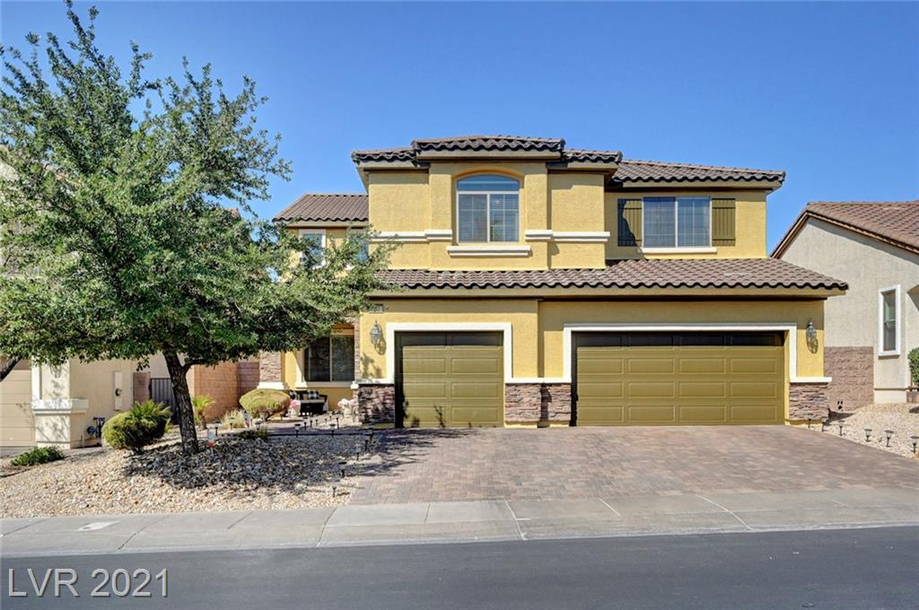 Former Lennar model home in ideal gated Henderson location!  Super convenient access to I-215 & I-95 interchange, shopping, dining, Water St. district and Lake Las Vegas!  This spacious home features over 3,200 feet, 5 potential bedrooms, 3-car garage, open floorplan, and fabulous backyard with pool/spa.  Don't miss this fantastic opportunity!