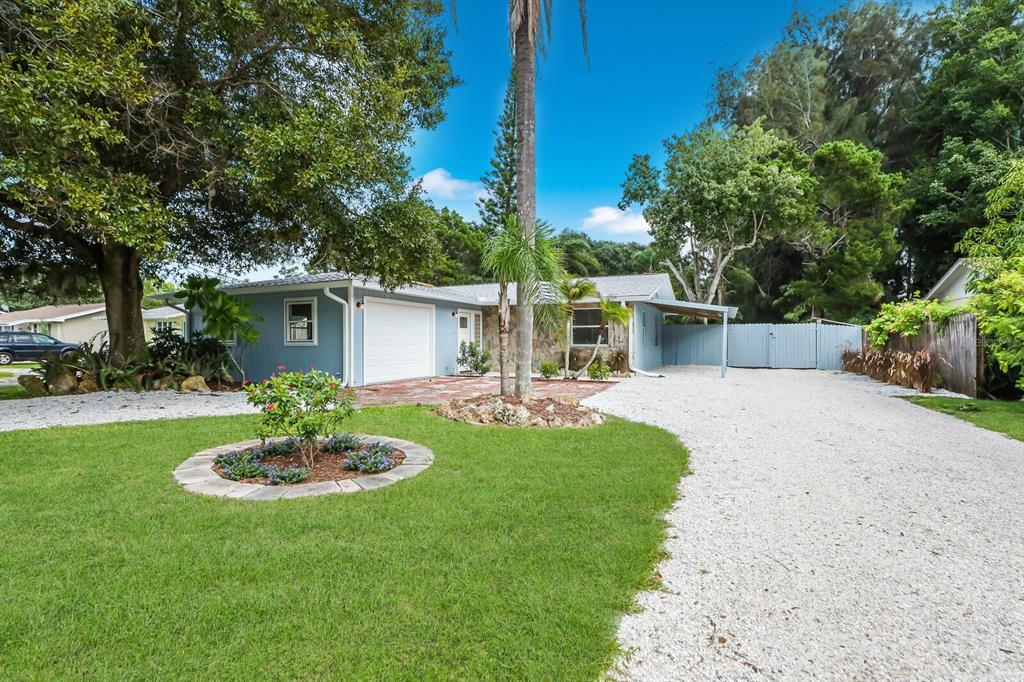 One or more photo(s) has been virtually staged. This is the one that you have been waiting for and it won't last long! Situated just a few miles from world class Siesta Key Beach and Downtown Sarasota, this gorgeous 2/2 sits on a generous 1/2-acre lot, complete with a working studio/workshop space where you can store your toys or get creative.  Having just undergone a total renovation, this sweet home is now ready for its new owner. Upgrades include a beautiful new kitchen with Shaker style cabinetry, quartz counters and all new stainless-steel appliances. Refitted bathrooms, new luxury vinyl and tile flooring has been installed throughout the home, many of the windows and doors have been replaced and the new HVAC system comes with a warranty! The roof was also replaced in 2018. Step outside your back door and you will find refreshed landscaping and a brand new paver patio where you can look out over the huge back yard!