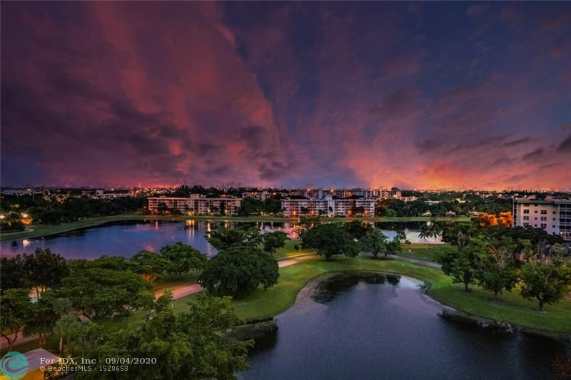 Dramatic sunset views from this fully remodeled corner unit overlooking Palm Aire's new lakes. This amazing light bright 3-bedroom features hurricane impact glass, 2019 A/C, Hot Water system & LG front load full sized sensor washer/dryer.  The open kitchen with pin bar lighting and seating features quartz counters, solid wood cabinetry with slow close technology (including pantry w/pull out drawers), Gallery series stainless appliances, stainless sink and hardware. Baths with 8-Jet Multi Function shower systems with rainfall heads and terazzo and solid wood vanities. There's privacy solar shades and drapery, tile throughout, recessed lighting, knockdown finish, ceilings fans, fire sprinklers, extra storage, an expanded patio, updated closet systems, all new doors. 720 FICO score required.