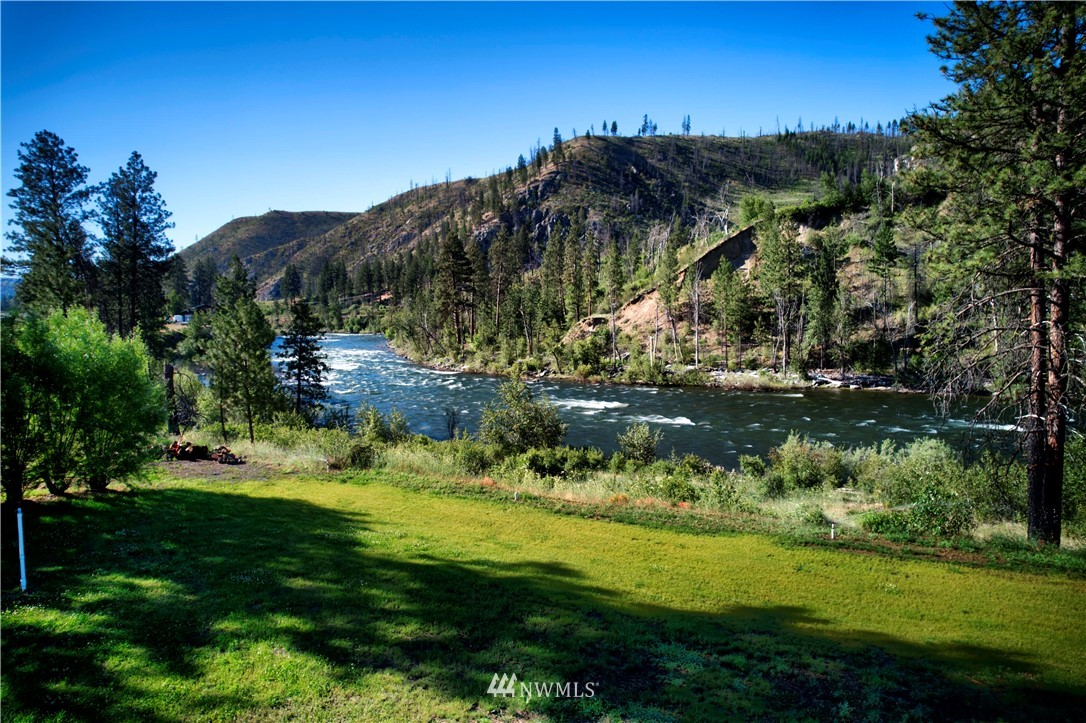 Enjoy the wildlife on this rare 4.8 acre low bank waterfront property right in the middle of the beautiful Methow valley. Imagine your home in this scenic location observing the abundant wildlife. Relax, fish or swim from the low bank for summer fun. Golf in Winthrop, Twisp, Alta Lake or Gamble Sands. Partially fenced to the river. The property has electricity and a 3 bedroom septic installed. Has an RV pad over-looking the river. Domestic well and irrigation rights keep it green during spring, summer and fall. Its a great getaway location for all your friends and maybe VRBO or Airbnb? Enjoy this outstanding getaway location. Neighboring house, garage with living space on 13.3 acres available in listing 1789383.