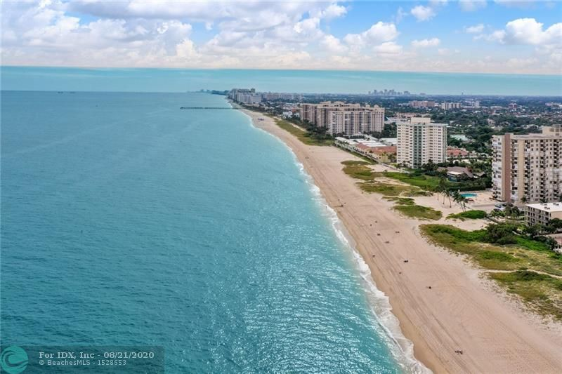 The ultimate in Beach Living. Once you enter this exceptional condo from the semi-private elevator, you will fall in love with it. Amazing direct Ocean Views and natural light in this desirable Southeast corner unit. High-end designer finishes throughout compliment the open layout of this residence. The Chef's kitchen features custom Cabinets, Jenn Air stainless steel appliances, Quartz counters and a breakfast area overlooking the ocean. The large master suite offers stunning sunset views. The bathrooms are appointed with exquisite Custom cabinetry, Quartz counters and tile work. Wide plank porcelain tile floors flow through the unit. Den/study used as 3rd bedroom. Enjoy Resort style amenities like the heated pool w/outdoor kitchen, gym, tennis & pickle ball, fire pits, putting green.