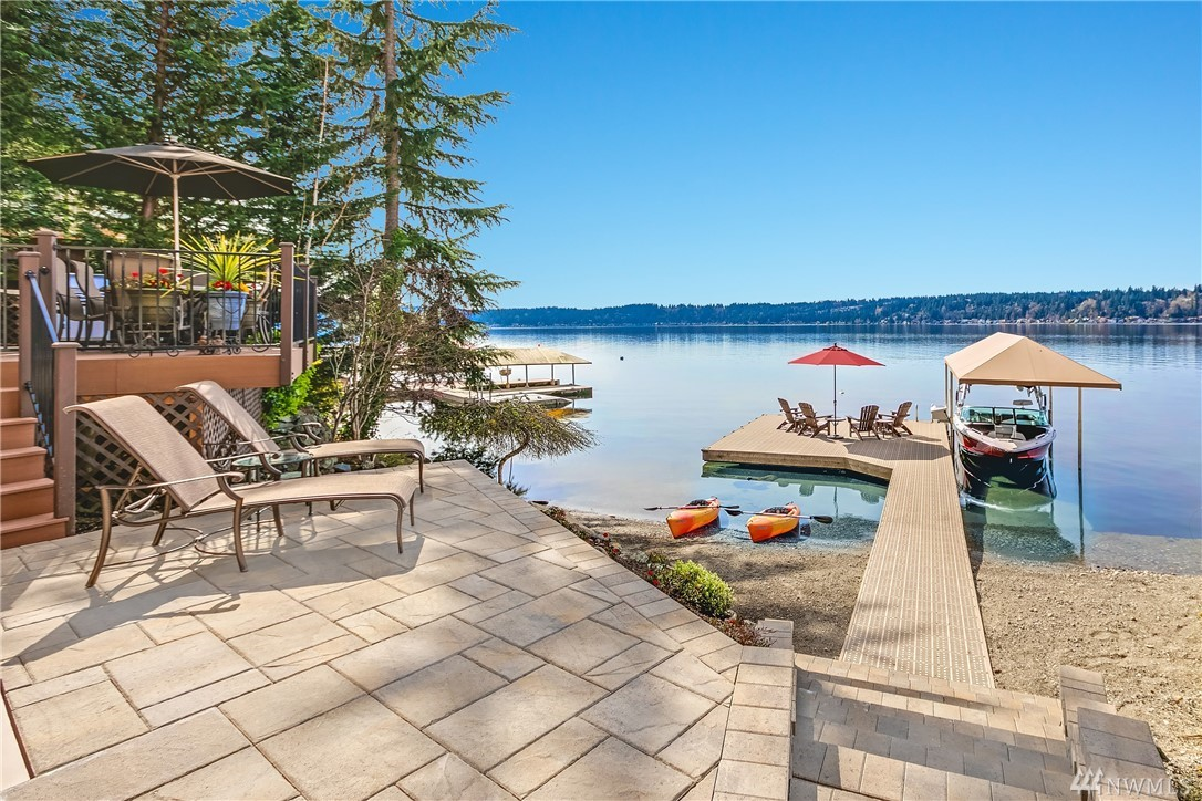 Experience the allure of the Mediterranean nestled along 60' of E Lake Sammamish waterfront. Vast westerly views extend beyond the shoreline revealing vivid sunset reflections. Hand-scraped hardwoods & rustic beams balance heritage style w/ the casual spirit of lakehouse living. Over $120K in upgrades, 2 addtl kitchens & heated floors. Retire to the dock for cocktails at the water's edge, gather by the fireside in the covered loggia & fall asleep to the gentle lapping of the waves. A lifestyle!
