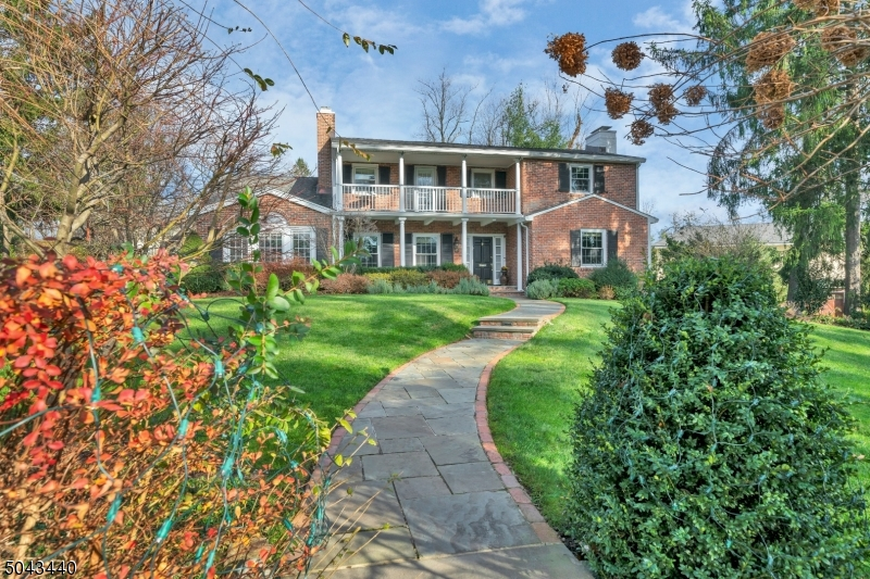 Rare find-Magnificent brick colonial nestled on a premier street! Sun filled residence with an incredible open floor plan & phenomenal entertaining spaces, 2 oversized FRs with radiant heat: 1 with a vaulted beamed ceiling, stone fireplace & 2 sets of double doors which open up to a large patio & private park-like yard. 2nd FR has vaulted ceiling, custom built-ins with bar & wine cooler & double doors open onto a large deck with BBQ grill. Refinished wood floors & Pella windows. Spacious LR & DR, state of the art gourmet eat-in kitchen & high-end appliances. Versatile floor plan: 1st Floor BR & newer bath. 2nd floor has a luxurious master suite with a spa like marble bath, 3 more BRs, bath & cedar closet. Stunning lower level has a fabulous vinyl floor, rec room, office/ bedroom, bath & mud room