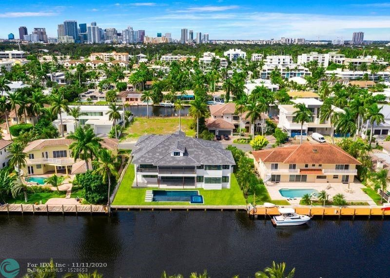 Offering the very latest in British West Indies design & construction! Winning collaboration between Tuthill Architecture & Gulf Builders this East facing residence offers custom quality construction plus open, functional floor plan designed for the ultimate SoFlo waterfront lifestyle. Located on one of the most desirable Las Olas Isles (underground utilities & majestic palms). Attention boaters canal 9ft at low tide & 110ft wide ensures great protected dockage upto 80ft. Enjoy amazing great room & open Chef's kitchen-dining-living concept. Separate Club/Game Room, Wine Cellar,1st level Bedroom. Large covered terrace & Summer Kitchen. Ultra-luxurious Master Suite with separate spa style baths & walk-in closets. Plus 3 large Bedroom Suites. Huge balcony. 3rd level Play/Media/Home Office.