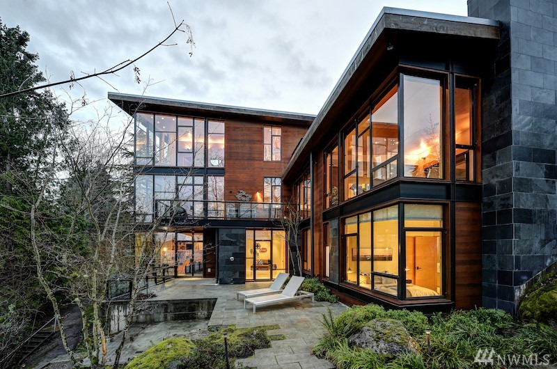 Iconic architecturally-advanced home offered on 113' of Lake WA no bank frontage. Designed by Geoffrey Prentiss. Built of steel and glass, softened by calibrated Montana slate and clear cedar. Maple-paneled ceilings, Wenge African hardwood. Hand-troweled Milestone bathroom walls. Radiant floor heating throughout. Low maint natural landscaping. 2 patios. 3 decks. Boat lift. Bald eagles.  500 sq ft apt above 3-car garage. This is premier PNW lakefront living.