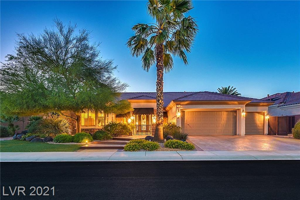 Why would anyone buy at this price without an almost perfect view of the Las Vegas strip and our gorgeous surrounding mountains?  This home has it all!  Stunning GOLD KEY CUSTOM nestled in the heart of Sun City Anthem; right between the main recreation center and the Revere golf club & restaurant.  Back yard with a very large patio plus, TWO raised viewing patios, large vanishing edge pool and raised spa, all with amazing straight-on strip & mountain views over the lush 18th fairway of the Lexington golf course.  As you enter this home you are greeted with a direct view of the city.  Very large great room so perfect for entertaining family and friends, open gourmet kitchen with granite, stainless, and lots of cabinets.  Elegant master suite with views, enlarged closet, & amazing bath with custom granite.  3-car cooled garage, totally separate guest suite and all with complete privacy.  Large custom office, Rolling security shutters and much more. This is an Entertainers Dream!
