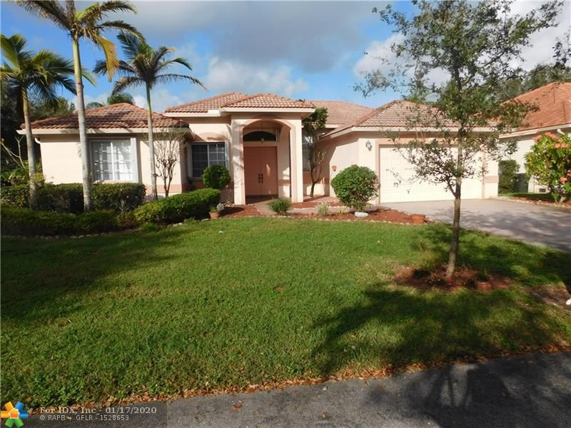 WOW.. THS IS A TURNKEY THAT SHOWS PRIDE OF OWNERSHIP. THIS 4 BED/2.5 POOL HOME IN REGENCY LAKES HAS EVERYTHING YOU'RE LOOKING FOR. WHAT A GEM IN A VERY SOUGHT AFTER REGENCY LAKES OF COCONUT CREEK! PERFECT FOR ENTERTAINING - LIVING AREAS HAVE CROWN MOLDING, NEUTRAL COLORED TILE FLOORING THROUGHOUT - PLENTY OF NATURAL LIGHT. VERY LARGE KITCHEN WITH BREAKFAST AREA AND STAINLESS STEEL APPLIANCES - OVERSIZED FAMILY ROOM VIEWS OF THE POOL AND LAKE - HOME IS LOCATED IN AN OVERSIZED CORNER LOT AND IS MOVE-IN- READY