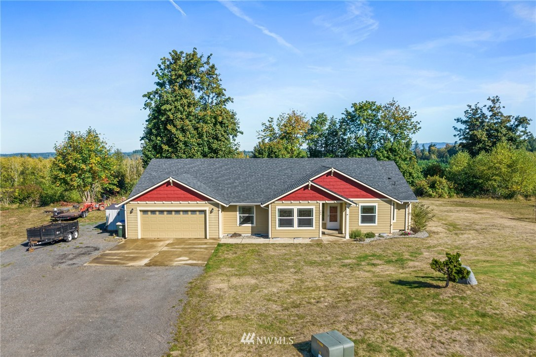 20 acres of beautiful and peaceful country living. The long drive leads you to a large three bedroom, two bathroom, single story home with beautiful territorial views around. Open concept living from the living room to dining to the kitchen, complete with island and walk in pantry.  Spacious utility room with additional storage and sink. Grand master suite with five piece bath and dual sink vanity. Bedrooms are spacious and offer walk in closets for ample storage. Peaceful outdoor space with level backyard space, garden space, and beautiful trees creating privacy. 10x10 metal tool shed and 8x10 chicken coop on property. Newer heat pump installed in home.