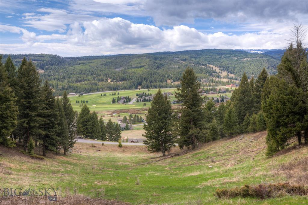 Site your new Big Sky home on this gorgeous 1.55 acre parcel in Big Sky's Sweetgrass Hills. Large, old growth trees, a gentle, sloping site, and a cul-de-sac location are some of the many positive attributes of this homesite. Two Gun White Calf is a quiet, highly desirable road overlooking Big Sky's Meadow Village. The property offers views of the Meadow Village, Golf Course, Town Center, and canyon. Utilities are to the property so it is ready for your Big Sky home!
