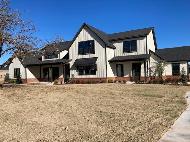 Gorgeous new home with a country feel. Small, quiet, culdesac street with gated entry. Edmond schools. 1 Acre lot. Trees in the front yard. Master, guest bed and study down. Large bonus room up with 2 bedrooms and bath.  Vaulted ceiling in living room.  Large mud room. Study has separate front entrance.