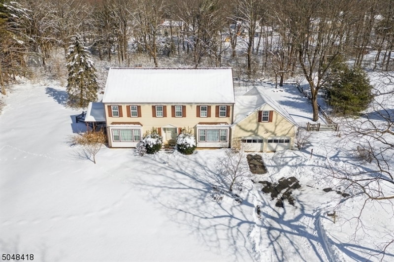 Beautiful, charming, large 5 BR, 2.5 BA Mendham Boro Colonial w/ pool. 5 spacious bedrooms w/large closets. Spacious/gracious LR & DR w/ over-sized windows providing bright light.Sunny eat-in kitchen, cozy family rm features a FP & walkout porch. HW Floors. Laundry rm & pantry off kitch w/walkout to beautiful backyard w/stunning pool. In the heart of Mendham on a quiet cul-de-sac. Put your personal touch on LL which has potential for a family rm, game rm, exercise area & storage. LL has walkout to backyard. Short walk to local Main Street shopping, grocery store, restaurants, schools, parks, Patriot's Path & convenience mall. Enjoy scenic walks in the woods at your leisure. Close to Mendham Borough Park, Gazebo, tennis, basketball, baseball fields. Full attic storage. May finish garage loft. Dead end st.