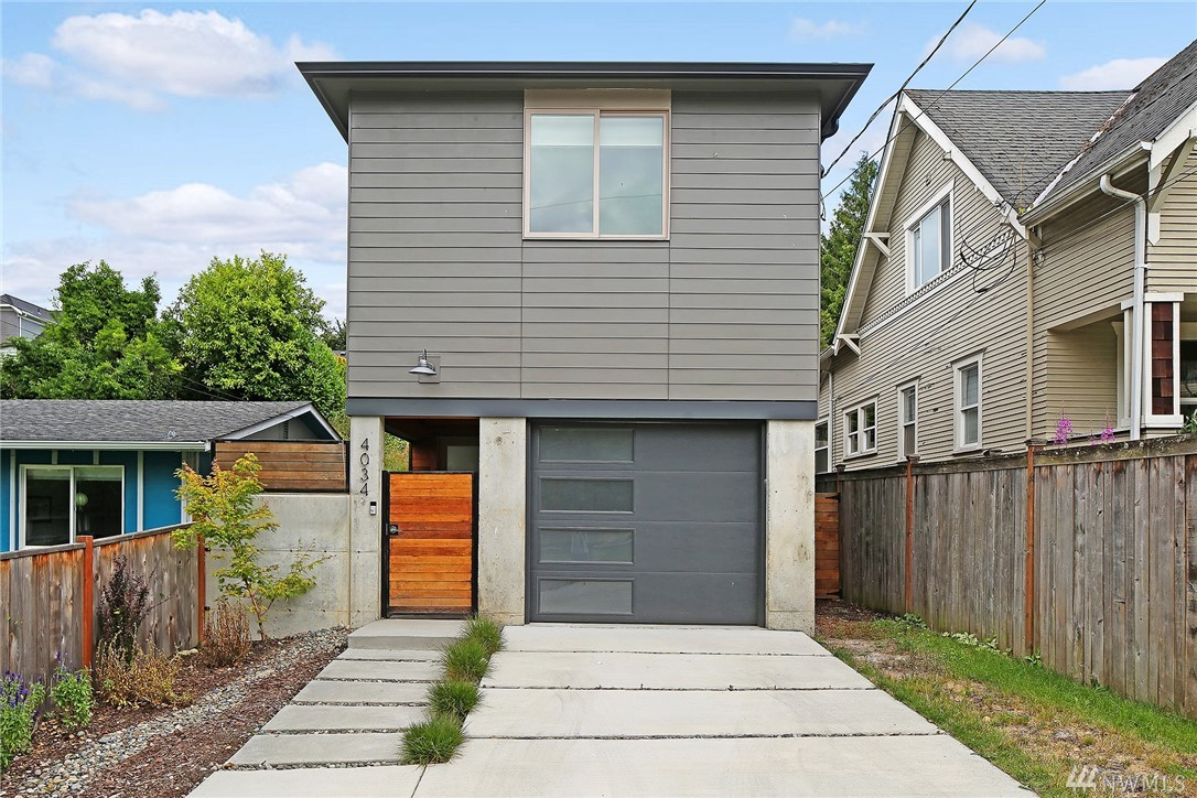 Welcome to a beautiful 2017 built stand alone home in the Pigeon Point neighborhood of West Seattle. Modern style & immaculate condition! You'll appreciate the thoughtful layout with all 3 bedrooms on the upper level, master suite includes private deck, washer/dryer upstairs, main level great room has kitchen w/eating space, dining area, living room with gas fireplace & opens to a private patio w/fully fenced yard. Features include gas furnace, tankless hot water heater & attached 1 car garage.