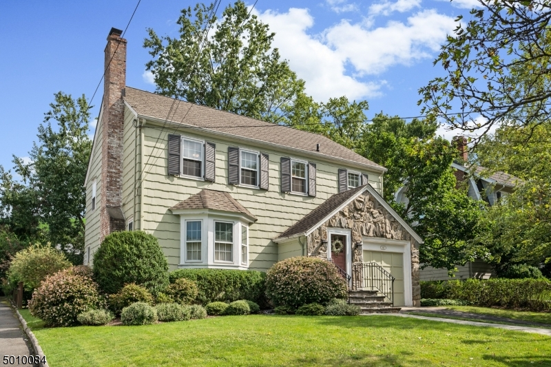 Don't be deceived, this home lives larger than you would think! This Maplewood Colonial has been meticulously cared for and is under a mile to town/train! The spacious living room features a large bay window & charming fireplace. The dining room flows directly from the living room w/plenty of space for entertaining. Enjoy the generous kitchen with chef's pantry, breakfast area PLUS adjacent sitting room. Upstairs, find 3 large BR, hall bath AND expansive primary suite featuring 3 closets & ENSUITE bath. Both the large basement & attic boast high ceilings w/endless possibilities for finishing! Outside, enjoy the custom patio overlooking the lush backyard with gorgeous plantings. This is home!