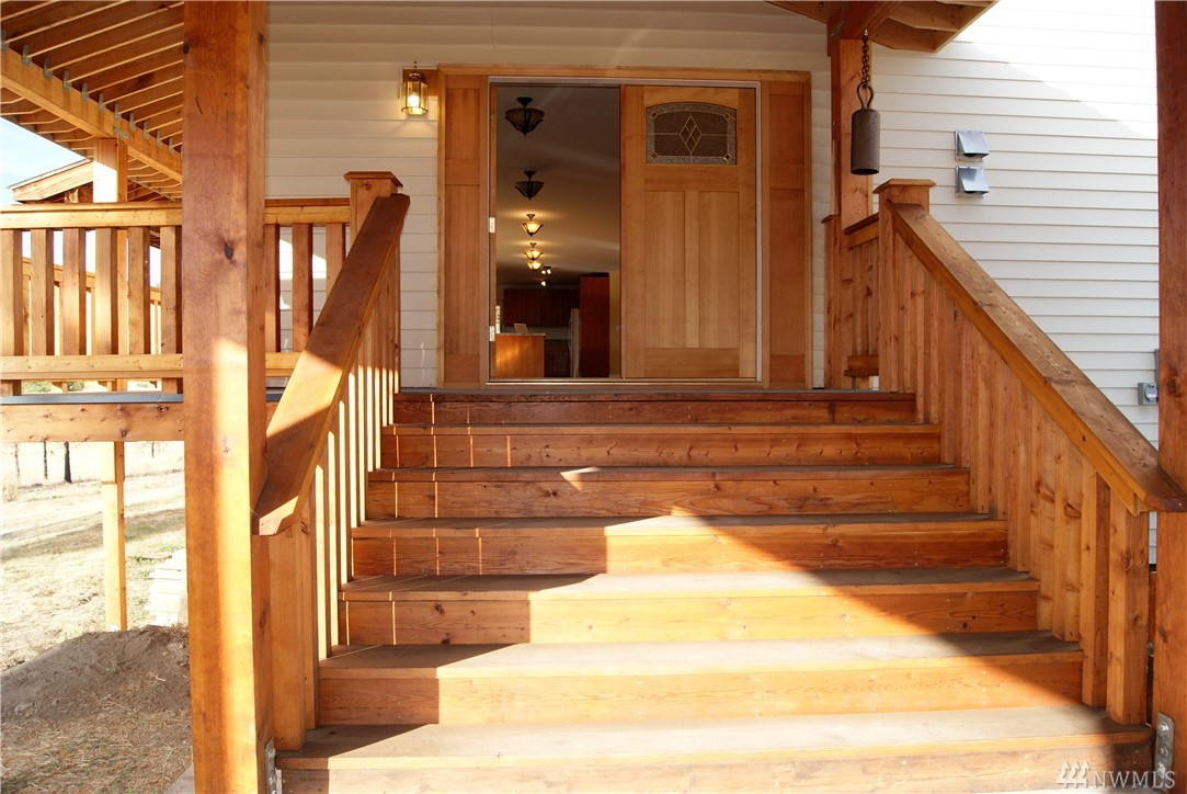 Carlton Sunny 60 Acres. Solar, Propane & Generator supply the energy. Endless Mtn. peak views.Large 12ft covered decks.Quality Finish 4,032 sf. w/ 4 bedroom/3 Full bath.Hardwood floors through-out.Outback system has (4) Four Solar panels w/ battery &block. 2,000 sf unfinished daylight basement systems & fixtures area. Generator Kohler brand for electric.Phone & Wi-Fi installed.Appliances included.Fenced Garden.On-site artesian well/septic system. Attached Carport. 3 Propane heaters & wood heat.